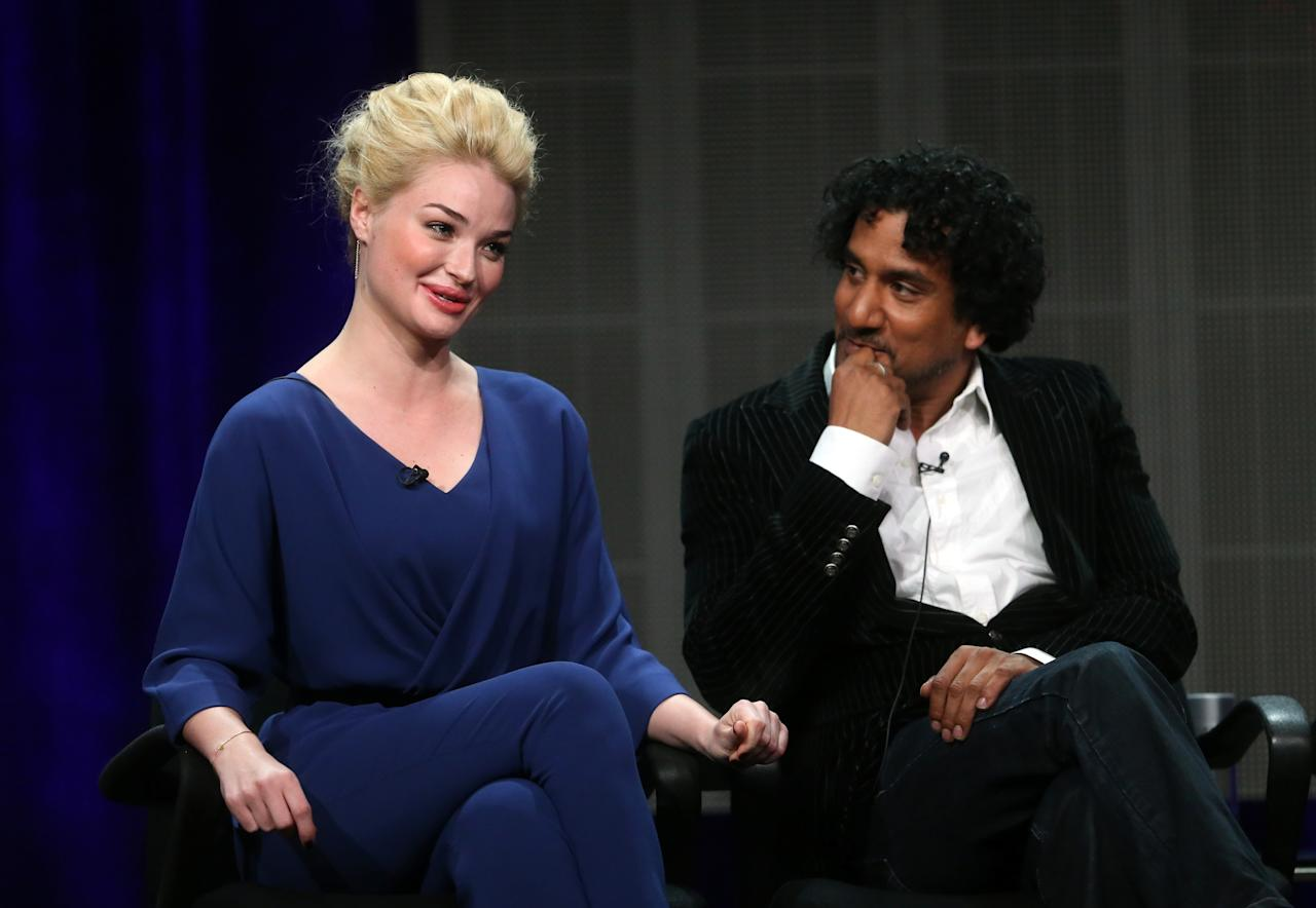 """BEVERLY HILLS, CA - AUGUST 04: Actors Emma Rigby (L) and Naveen Andrews speak onstage during the """"Once Upon a Time in Wonderland"""" panel discussion at the Disney/ABC Television Group portion of the Television Critics Association Summer Press Tour at the Beverly Hilton Hotel on August 4, 2013 in Beverly Hills, California. (Photo by Frederick M. Brown/Getty Images)"""