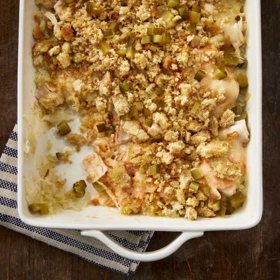 "<p>This Reuben casserole recipe has all the delicious elements of a Reuben sandwich with much less sodium and calories. Thinly sliced angel hair cabbage cooked with a splash of vinegar stands in for the sauerkraut, and lower-sodium deli turkey adds a rich, meaty flavor in place of the traditional corned beef. <a href=""http://www.eatingwell.com/recipe/277675/reuben-casserole/"" rel=""nofollow noopener"" target=""_blank"" data-ylk=""slk:View recipe"" class=""link rapid-noclick-resp""> View recipe </a></p>"