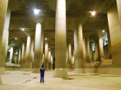 """The pressure-controlled water tank at the Metropolitan Area Outer Underground Discharge Channel in Kusakabe, north of Tokyo. The facility, which is believed to be one of the largest facilities in the world, is composed of giant concrete containment silos (65m tall, 32m wide), connected by 3.97 miles of underground tunnels 50m beneath the surface as well as a large water tank called the """"Underground Temple"""" which is 25.4m tall, with a length of 177m and 78m wide, with 59 concrete pillars. <br><br>(Photo: REUTERS/Ministry of Land, Infrastructure, Transport and Tourism-Edogawa River Office/Handout)"""