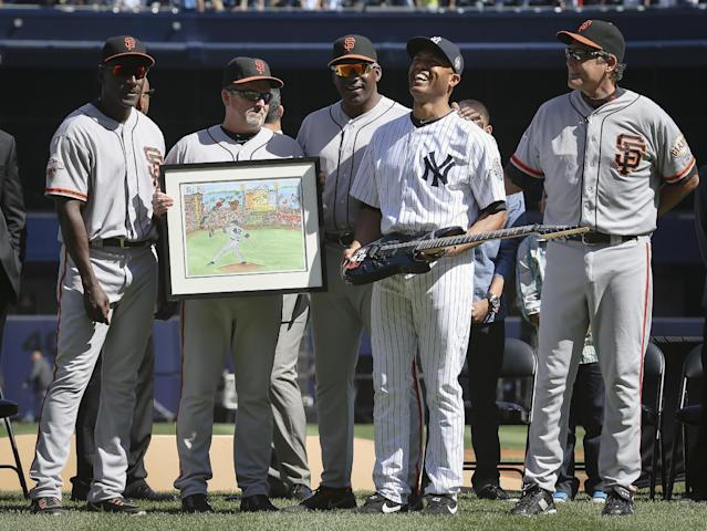 From left, San Francisco Giants first base coach Roberto Kelly (39), Giants assistant hitting coach Joe Lefebvre (5), Giants pitching coach Dave Righetti (33), New York Yankees relief pitcher Mariano Rivera (42), and Giants pitching coach Dave Righetti (33) pose for a photograph after the Giants presented Rivera with gifts as he is honored in a pregame ceremony at Yankees Stadium before a baseball game, Sunday, Sept. 22, 2013, in New York. The 13-time All-Star closer is retiring at the end of this season. (AP Photo/John Minchillo)