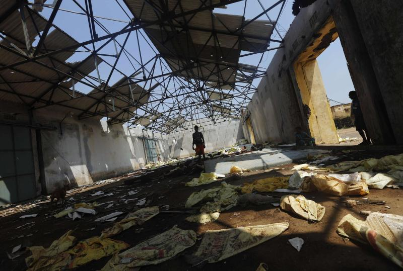 A fisherman walks inside a damaged port building after Cyclone Phailin hit Gopalpur village