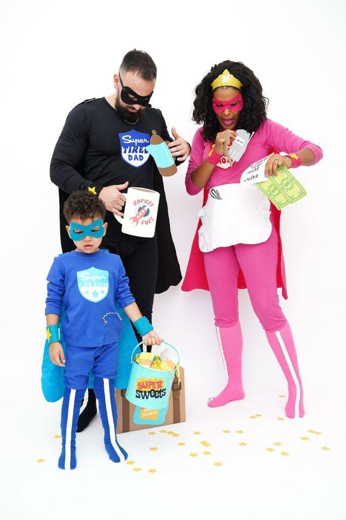 """<p>Because even the strongest, most magical superheroes can't do it alone! Here, """"Busy Mom,"""" """"Super Tired Dad,"""" and """"Super Kid"""" model one of the most original three-person costumes to date.</p><p><strong>Get the tutorial at <a href=""""https://damasklove.com/how-to-make-family-superhero-costumes-with-cricut/"""" rel=""""nofollow noopener"""" target=""""_blank"""" data-ylk=""""slk:Damask Love"""" class=""""link rapid-noclick-resp"""">Damask Love</a>.</strong></p><p><strong><a class=""""link rapid-noclick-resp"""" href=""""https://go.redirectingat.com?id=74968X1596630&url=https%3A%2F%2Fwww.walmart.com%2Fsearch%2F%3Fquery%3Dcapes&sref=https%3A%2F%2Fwww.thepioneerwoman.com%2Fhome-lifestyle%2Fcrafts-diy%2Fg37066817%2Fhalloween-costumes-for-3-people%2F"""" rel=""""nofollow noopener"""" target=""""_blank"""" data-ylk=""""slk:SHOP CAPES"""">SHOP CAPES</a><br></strong></p>"""