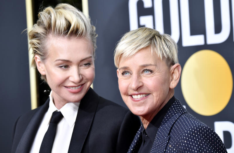 Portia de Rossi and Ellen DeGeneres cuddle in a new photo marking National Coming Out Day. (Photo: Frazer Harrison/Getty Images)
