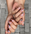 """Boston nail artist <a href=""""https://www.instagram.com/p/B0tMskgjS07/?hl=en"""" rel=""""nofollow noopener"""" target=""""_blank"""" data-ylk=""""slk:Nina Park"""" class=""""link rapid-noclick-resp"""">Nina Park</a> creates some of the prettiest floral manicures we've ever seen. So it's no surprise her most frequently requested design involves flowers. """"I've noticed people are always in love with floral nail art, regardless of season,"""" she says. """"There's something really bold yet delicate about a floral manicure."""" She alternates between hand-painting floral tips and applying nail wraps. Either way, the results are always gorgeous."""