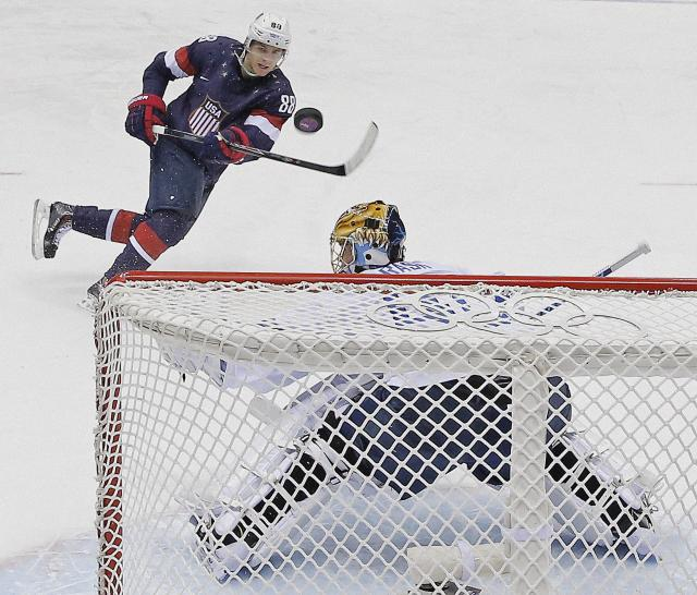 USA forward Patrick Kane hits the post as he shoots on Finland goaltender Tuukka Rask during the second period of the men's bronze medal ice hockey game at the 2014 Winter Olympics, Saturday, Feb. 22, 2014, in Sochi, Russia. (AP Photo/David J. Phillip)