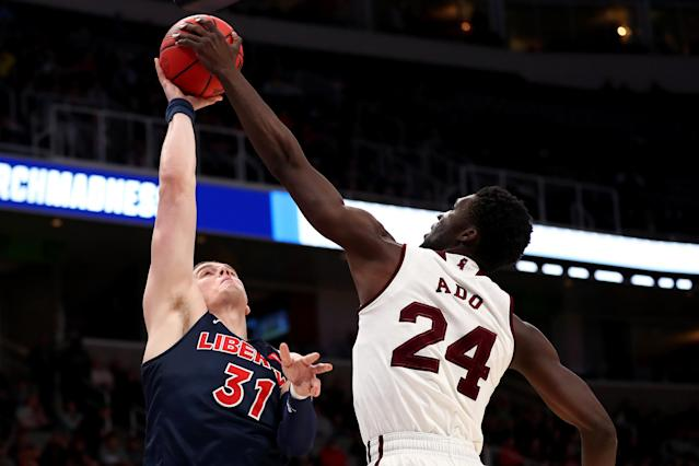 <p>Abdul Ado #24 of the Mississippi State Bulldogs blocks a shot by Scottie James #31 of the Liberty Flames during their game in the First Round of the NCAA Basketball Tournament at SAP Center on March 22, 2019 in San Jose, California. (Photo by Yong Teck Lim/Getty Images) </p>