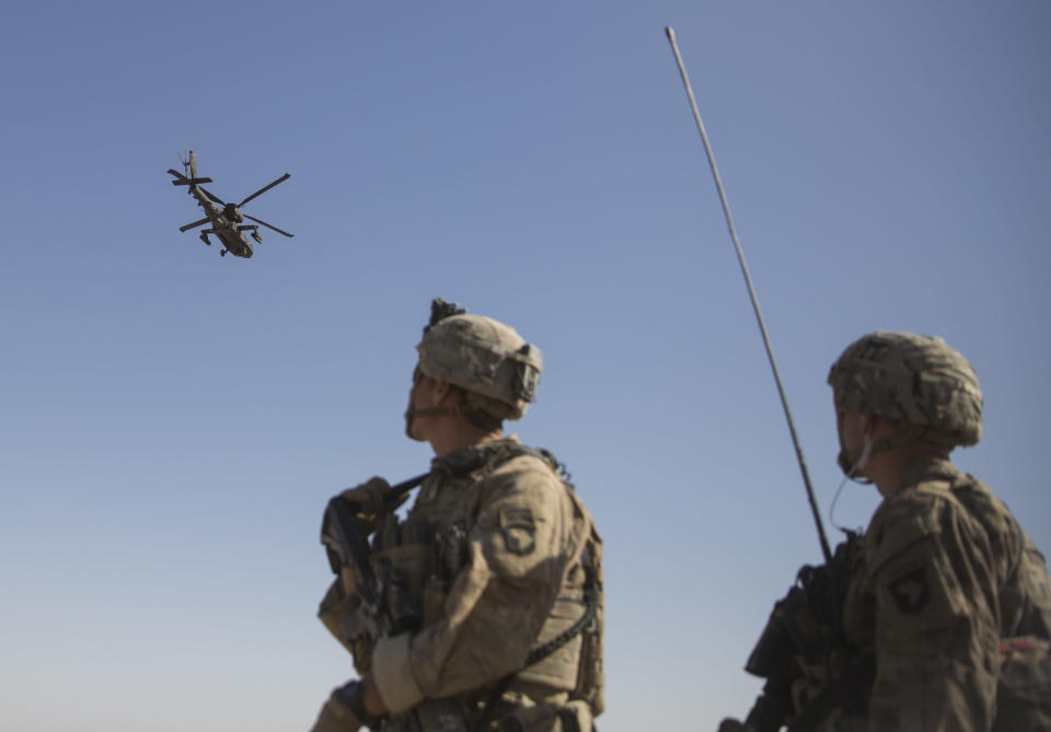 """FILE - This June 10, 2017 file photo released by the U.S. Marine Corpsshows an AH-64 Apache attack helicopter provides security from above while CH-47 Chinooks drop off supplies to U.S. Soldiers with Task Force Iron at Bost Airfield, Afghanistan. When he pulled the plug on the American war in Afghanistan, President Joe Biden said the reasons for staying, 10 years after the death of al-Qaida leader Osama bin Laden, had become """"increasingly unclear."""" Now that the final withdrawal is under way, questions about clarity have shifted to Biden's post-withdrawal plan. (U.S. Marine Corps photo by Sgt. Justin T. Updegraff, Operation Resolute Support via AP)"""