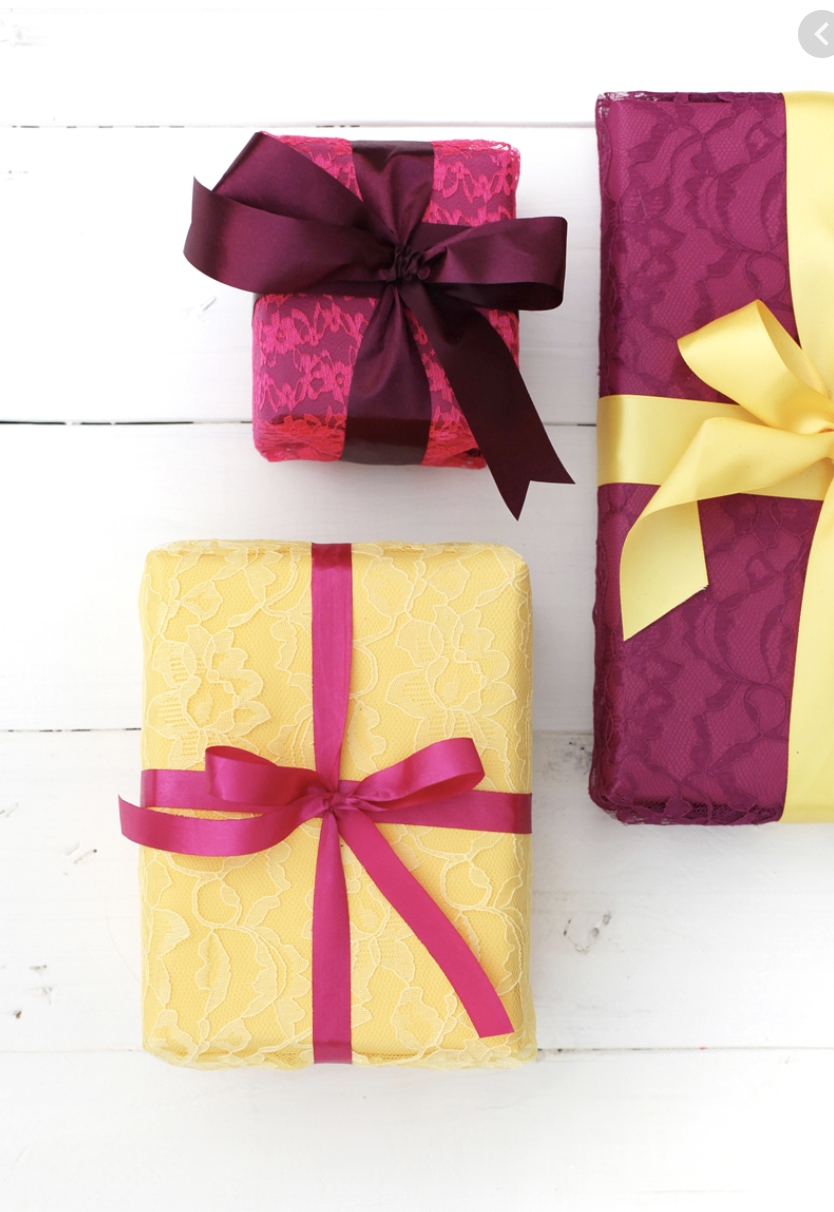 """<p>Make presents feel extra-special by layering jewel-toned paper with lace, then adding a coordinating satin ribbon. </p><p>Get the tutorial at <a href=""""https://abeautifulmess.com/lace-wrapping-paper-gifts/"""" rel=""""nofollow noopener"""" target=""""_blank"""" data-ylk=""""slk:A Beautiful Mess"""" class=""""link rapid-noclick-resp"""">A Beautiful Mess</a>.</p><p><a class=""""link rapid-noclick-resp"""" href=""""https://www.amazon.com/White-Raschel-Lace-Fabric-Sold/dp/B00T8XOHSQ?tag=syn-yahoo-20&ascsubtag=%5Bartid%7C10072.g.34015639%5Bsrc%7Cyahoo-us"""" rel=""""nofollow noopener"""" target=""""_blank"""" data-ylk=""""slk:SHOP LACE"""">SHOP LACE</a></p>"""