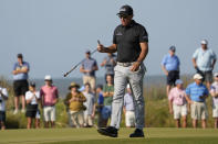 Phil Mickelson walks off the green after saving par on the 14th hole during the second round of the PGA Championship golf tournament on the Ocean Course Friday, May 21, 2021, in Kiawah Island, S.C. (AP Photo/David J. Phillip)
