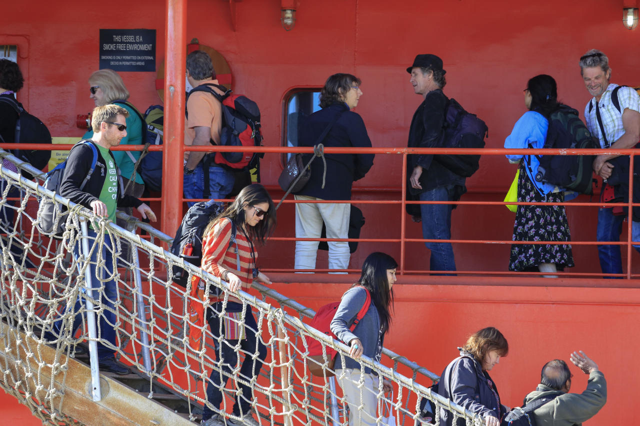 <p> Passengers disembark from the Aurora Australis in Hobart, Australia Wednesday, Jan. 22, 2014, following their rescue from a ship trapped in ice in the Antarctic. The ship rescued 52 passengers with the help of a helicopter from a Chinese ship on Jan. 2, 2014 after the Russian icebreaker Akademik Shokalskiy became trapped in ice-clogged Commonwealth Bay on Christmas Eve 2013.(AP Photo/AAP, Rob Blakers) AUSTRALIA OUT, NEW ZEALAND OUT, PAPUA NEW GUINEA OUT, SOUTH PACIFIC OUT, NO SALES, NO ARCHIVES