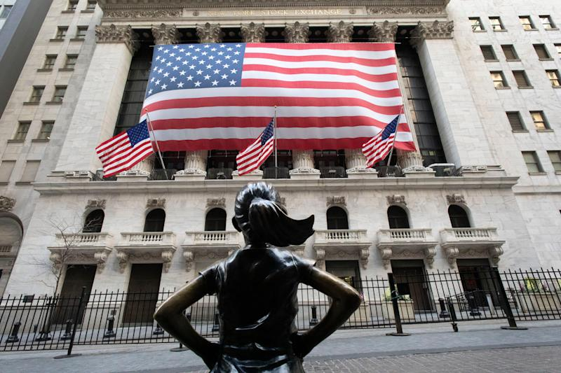 "The ""Fearless Girl"" statue stands in front of the New York Stock Exchange on March 16, 2020."