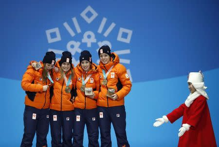 Medals Ceremony - Short Track Speed Skating Events - Pyeongchang 2018 Winter Olympics - Women's 3000 m - Medals Plaza - Pyeongchang, South Korea - February 21, 2018 - Bronze medalists Suzanne Schulting, Yara Van Kerkhof, Lara van Ruijven, Jorien ter Mors of the Netherlands on the podium. REUTERS/Kim Hong-Ji