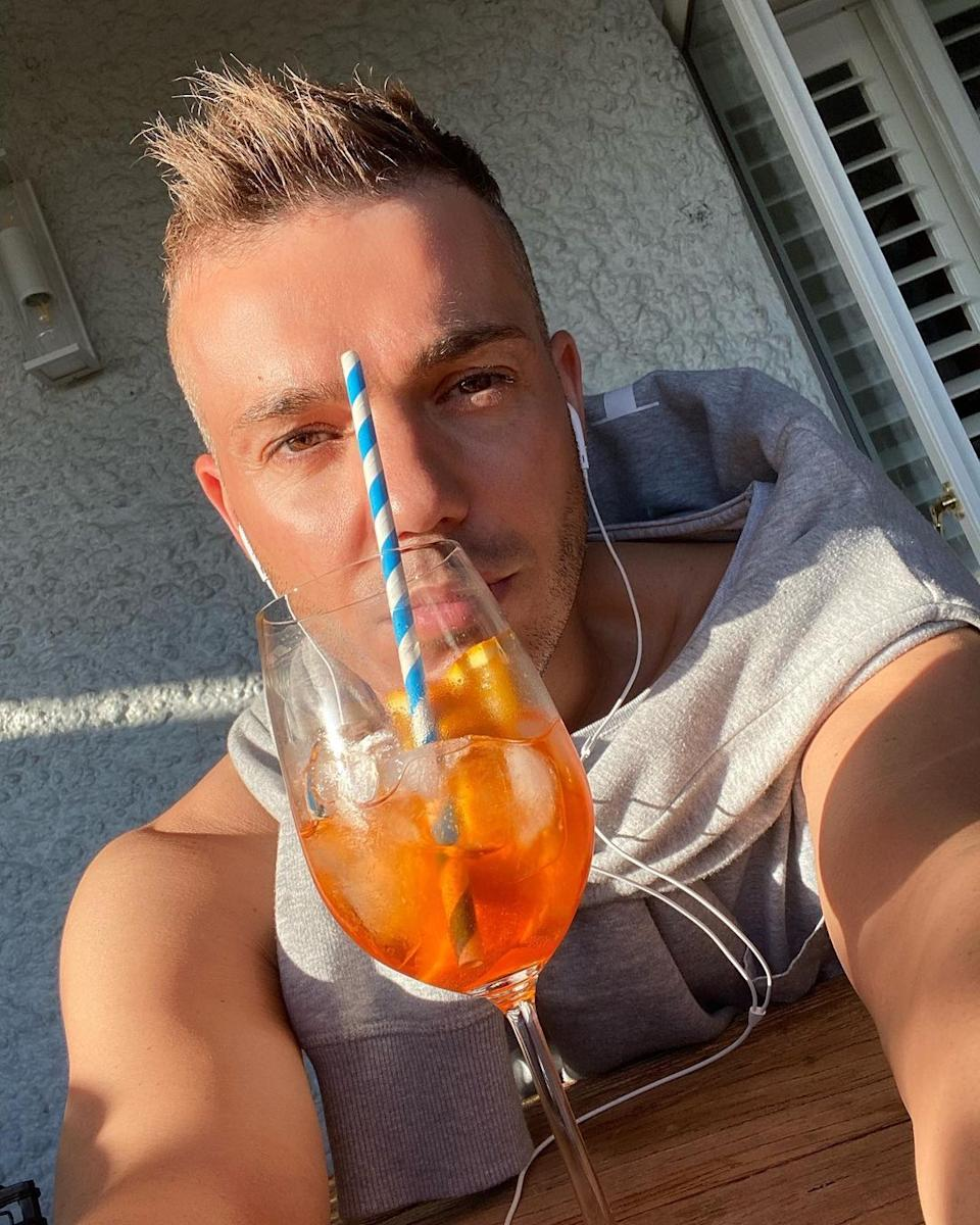 Anthony Callea takes a selfie with a cocktail