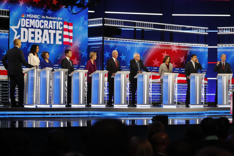 Democratic presidential candidates from left, Sen. Cory Booker, D-N.J., Rep. Tulsi Gabbard, D-Hawaii, Sen. Amy Klobuchar, D-Minn., South Bend, Ind., Mayor Pete Buttigieg, Sen. Elizabeth Warren, D-Mass., former Vice President Joe Biden, Sen. Bernie Sanders, I-Vt., Sen. Kamala Harris, D-Calif., former technology executive Andrew Yang and investor Tom Steyer participate in a Democratic presidential primary debate, Wednesday, Nov. 20, 2019, in Atlanta. (AP Photo/John Bazemore)