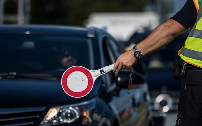 epa06028713 Border police check cars at the control station Schwarzbach on the motorway between Salzburg and Munich (A8) near Bad Reichenhall, Germany, 14 June 2017. Checks at the German border to Austria have been in place since 2016 as a reaction to the refugee situation in Europe. To ensure security at the upcoming G20 summit in Hamburg occasional border checks to all German neighbor countries started 12 June 2017. EPA/CHRISTIAN BRUNA - CHRISTIAN BRUNA/EPA