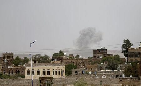 Smoke rises from a military post after it was hit by an air strike in Sanaa April 11, 2015. REUTERS/Khaled Abdullah