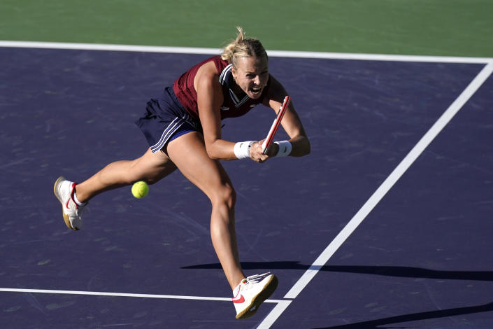 Anett Kontaveit, of Estonia, hits a backhand to Ons Jabeur, of Tunisia, at the BNP Paribas Open tennis tournament Thursday, Oct. 14, 2021, in Indian Wells, Calif. (AP Photo/Mark J. Terrill)