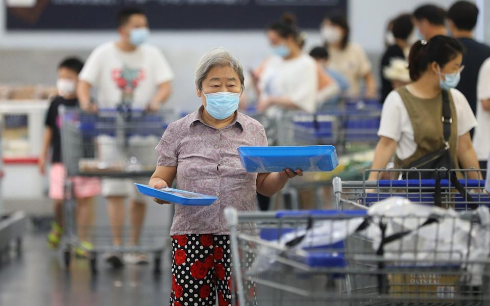 Customers wearing face masks shop for food at Sam's Club on August 4, 2021 in Nanjing, Jiangsu Province of China - China News Service