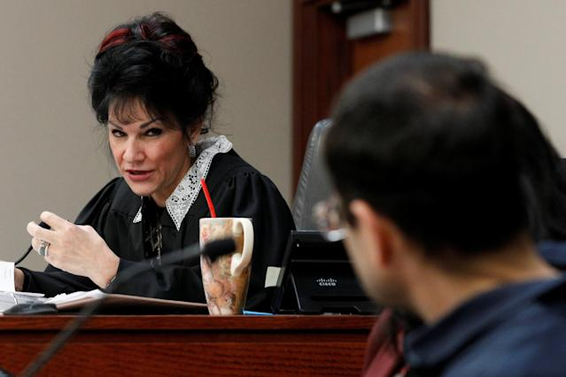 Circuit Court Judge Rosemarie Aquilina addresses Larry Nassar (R), a former team USA Gymnastics doctor who pleaded guilty in November 2017 to sexual assault charges, during his sentencing hearing. (REUTERS)