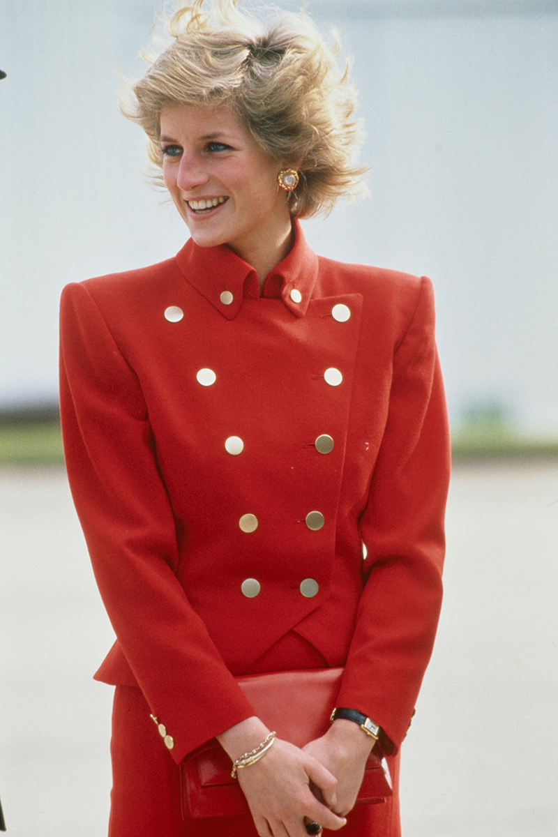 <p>Diana wore this scarlet red skirt suit with padded '80s shoulders and snazzy gold buttons during a visit to RAF Wittering in October 1989.</p>