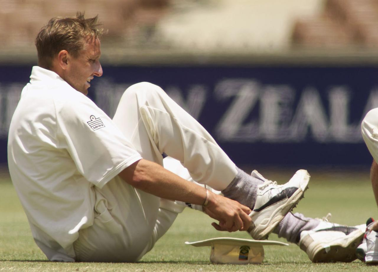 9 Dec 2001:  Allan Donald of South Africa changes his boots, during day three of the four day tour match between Western Australia and South Africa, played at The WACA, Perth, Australia. DIGITAL IMAGE. Mandatory Credit: Hamish Blair/ALLSPORT