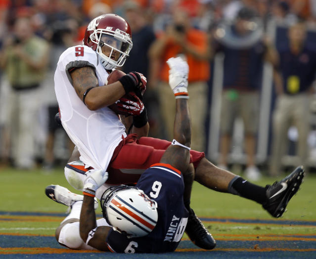 Washington State wide receiver Gabe Marks (9) catches a pass over Auburn defensive back Jonathon Mincy (6) for a first down during the first half of an NCAA college football game on Saturday, Aug. 31, 2013, in Auburn, Ala. (AP Photo/Butch Dill)