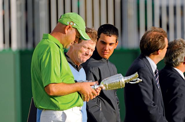 """<div class=""""caption""""> After his playoff victory, Cink looks at the claret jug with Watson and low amateur Matteo Manassero. </div> <cite class=""""credit"""">J.D. Cuban</cite>"""