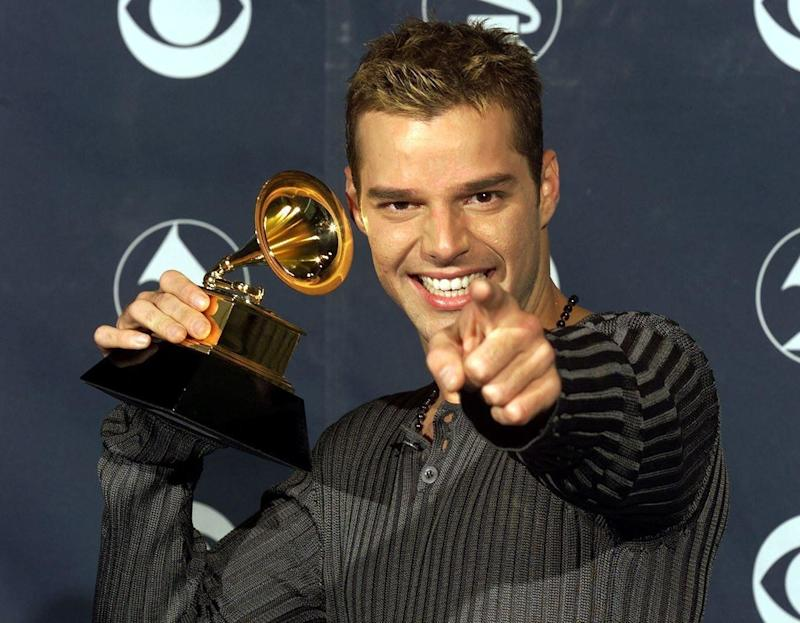 "Ricky Martin with his Grammy Award for ""Vuelve"" on February 24, 1999 at the Shrine Auditorium in Los Angeles."