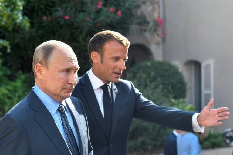 French President Emmanuel Macron will host Russian leader Vladimir Putin in Paris on Monday as part of his new strategy to directly engage with Moscow (AFP Photo/GERARD JULIEN)