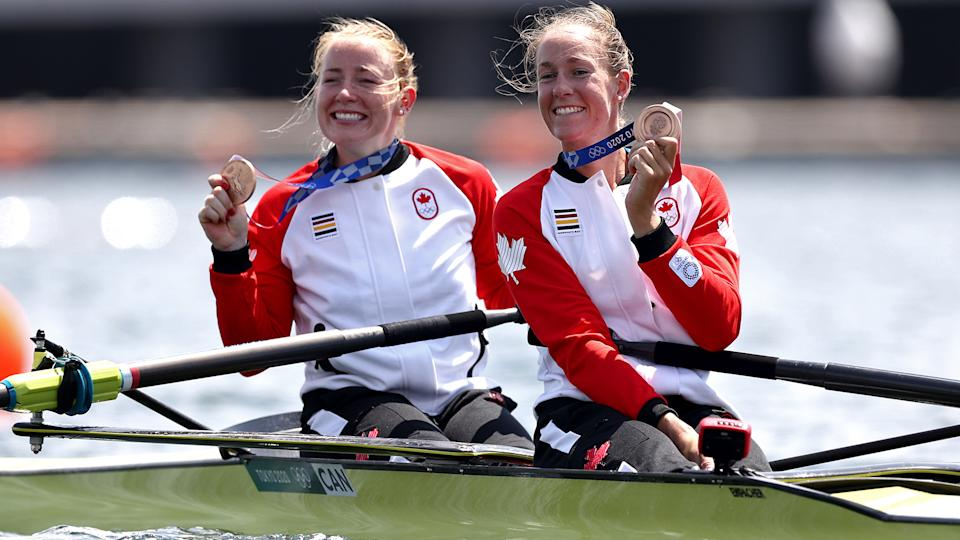 TOKYO, JAPAN - JULY 29:  Bronze medalists Caileigh Filmer and Hillary Janssens of Team Canada pose with their medals following the medal ceremony for the Women's Pair Final A on day six of the Tokyo 2020 Olympic Games at Sea Forest Waterway on July 29, 2021 in Tokyo, Japan. (Photo by Maja Hitij/Getty Images)