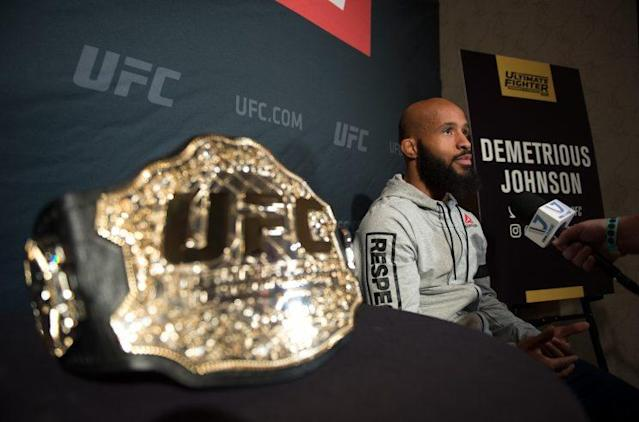 UFC flyweight champ Demetrious Johnson (R) will fight Ray Borg after a bizarre public blowup with UFC president Dana White. (Getty)