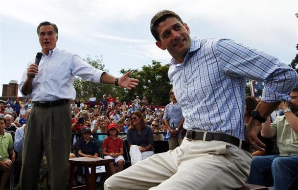 Mitt Romney (L) and Paul Ryan, hold a town hall meeting campaign stop in Manchester, New Hampshire August 20, 2012.