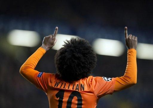 Shakhtar Donetsk's Brazilian player Willian celebrates after scoring against Chelsea in the UEFA Champions League at Stamford Bridge on November 7, 2012. Shakhtar won the last edition of the UEFA Cup in 2009 but the club is now enjoying what could be its best ever season -- outclassing rivals Dynamo Kiev to head the Ukrainian domestic league and into the last 16 of the Champions League
