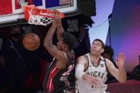Miami Heat's Jimmy Butler dunks past Milwaukee Bucks' Brook Lopez during overtime of an NBA conference semifinal playoff basketball game Sunday, Sept. 6, 2020, in Lake Buena Vista, Fla. (AP Photo/Mark J. Terrill)