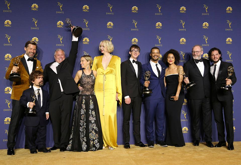 """Nikolaj Coster-Waldau, from left, Peter Dinklage, Conleth Hill, Emilia Clarke, Gwendoline Christie, Isaac Hempstead Wright, Jacob Anderson, Nathalie Emmanuel, Liam Cunningham, and Kit Harington pose in the press room with the award for outstanding drama series for """"Game of Thrones"""" at the 70th Primetime Emmy Awards on Monday, Sept. 17, 2018, at the Microsoft Theater in Los Angeles. (Photo by Willy Sanjuan/Invision for the Television Academy/AP Images)"""