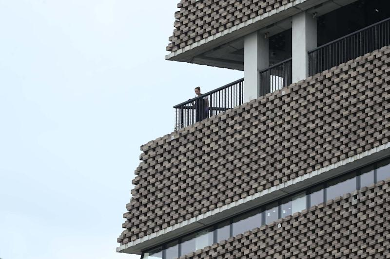 A police officer looks out from the viewing platform. (PA)