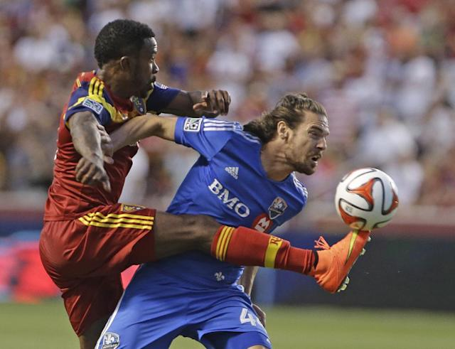 Real Salt Lake's Robbie Findley, left, kicks the ball as Montreal Impact's Heath Pearce (44) defends during the first half of an MLS soccer game on Thursday, July 24, 2014, in Sandy, Utah. (AP Photo/Rick Bowmer)