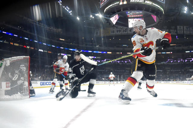 Calgary Flames center Elias Lindholm, right, scores on Los Angeles Kings goaltender Calvin Petersen, left, as defenseman Sean Walker, second from right, watches during the third period of an NHL hockey game Thursday, Feb. 13, 2020, in Los Angeles. The Kings won 5-3. (AP Photo/Mark J. Terrill)