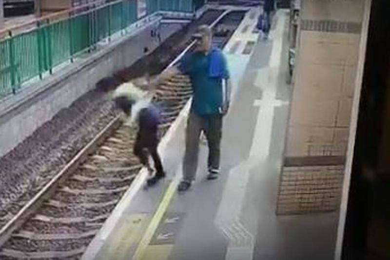 Shocking footage: The moment a man shoves a woman onto train tracks in Hong Kong: Facebook