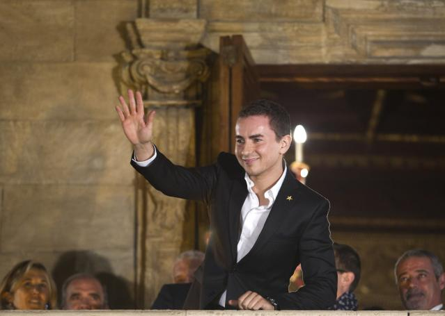 Moto GP world champion Spain's rider Jorge Lorenzo waves to the crowd from a balcony in Palma de Mallorca during a parade on November 19, 2012. AFP PHOTO/ JAIME REINAJAIME REINA/AFP/Getty Images