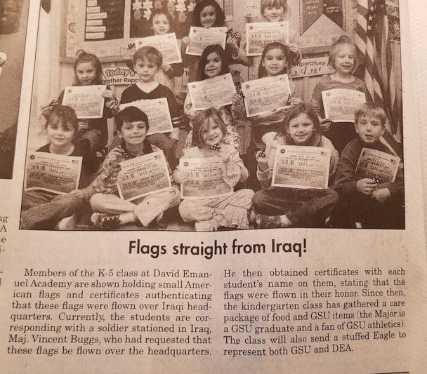 PHOTO: A local newspaper ran coverage of David Emanuel Academy students receiving American flags and certificates from Gen. Vincent Buggs. (David Emanuel Academy)