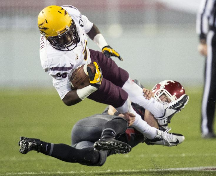 Washington State safety Casey Locker, bottom, tackles Arizona State wide receiver Richard Smith during the second half of an NCAA college football game on Thursday, Oct. 31, 2013, at Martin Stadium in Pullman, Wash. Arizona State won 55-21. (AP Photo/Dean Hare)