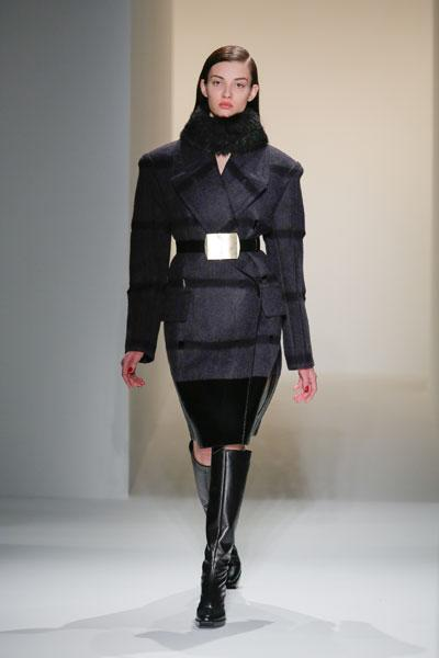 <b>Calvin Klein AW13 runway </b><br><br>This model donned a grey wool coat with power shoulders.<br><br>Image © Getty