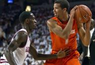 Syracuse's Michael Carter-Williams (1) looks to pass as Arkansas' Mardracus Wade, left, defends during the first half an NCAA college basketball game in Fayetteville, Ark., Friday, Nov. 30, 2012. (AP Photo/Gareth Patterson)