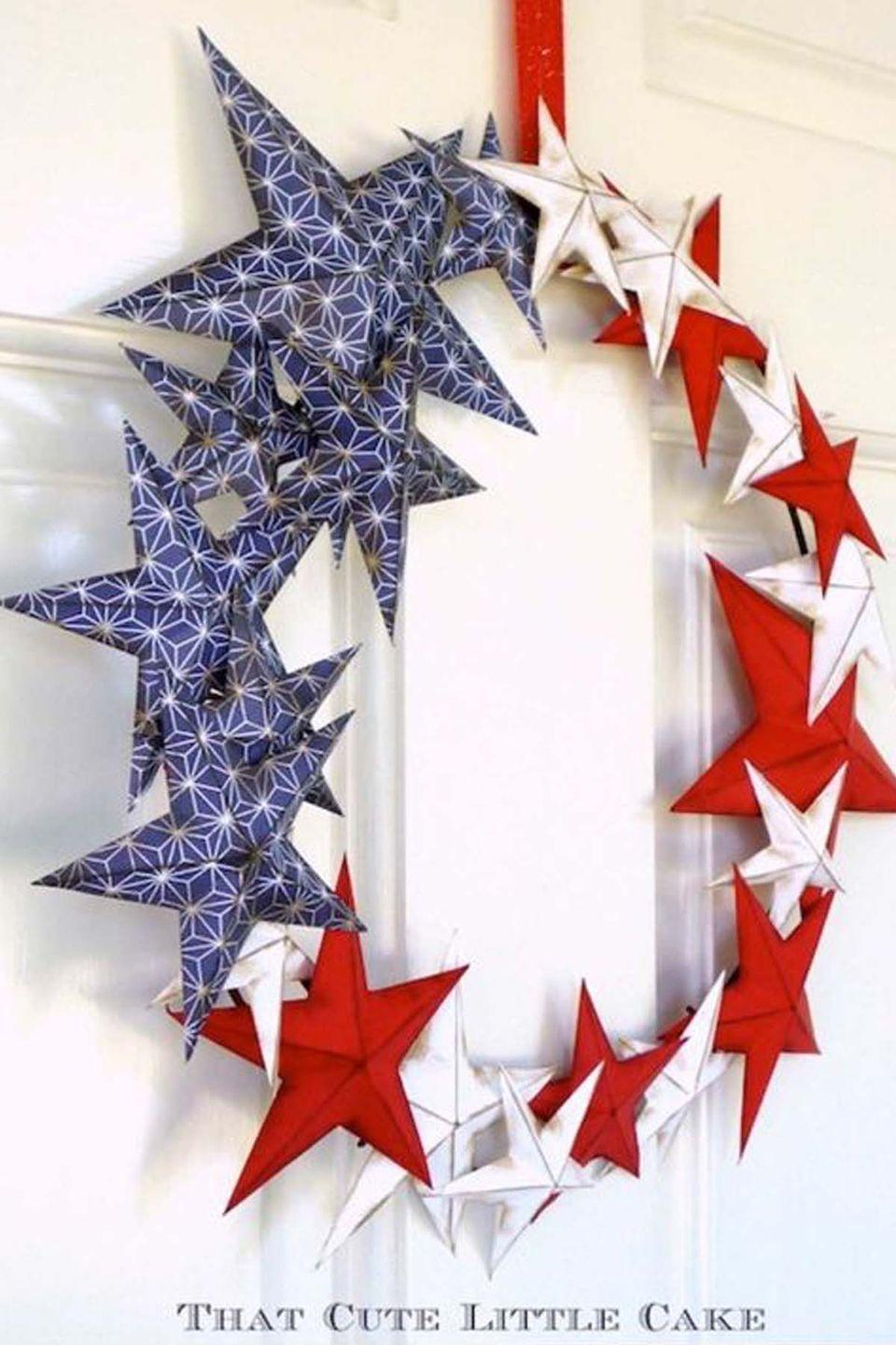 """<p>This stellar number will look stunning on your front door, mantel, or window. </p><p><strong>Get the tutorial at <a href=""""http://www.thatcutelittlecake.com/2014/05/craft-patriotic-wreath-4th-july.html?spref=pi"""" rel=""""nofollow noopener"""" target=""""_blank"""" data-ylk=""""slk:That Cute Little Cake"""" class=""""link rapid-noclick-resp"""">That Cute Little Cake</a>. </strong> </p><p><strong><a class=""""link rapid-noclick-resp"""" href=""""https://www.amazon.com/CVHOMEDECO-Country-Rustic-Antique-Vintage/dp/B06ZZVGFGF/ref=sr_1_1?tag=syn-yahoo-20&ascsubtag=%5Bartid%7C10050.g.4464%5Bsrc%7Cyahoo-us"""" rel=""""nofollow noopener"""" target=""""_blank"""" data-ylk=""""slk:SHOP METAL STARS"""">SHOP METAL STARS </a></strong></p>"""