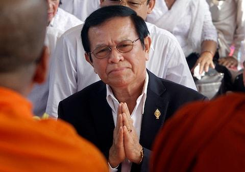 In this March 30, 2017, file photo, leader of the opposition Cambodia National Rescue Party Kem Sokha prays during a Buddhist ceremony to mark the 20th anniversary of the attack on anti-government protesters in 1997, in Phnom Penh, Cambodia - Credit:  AP