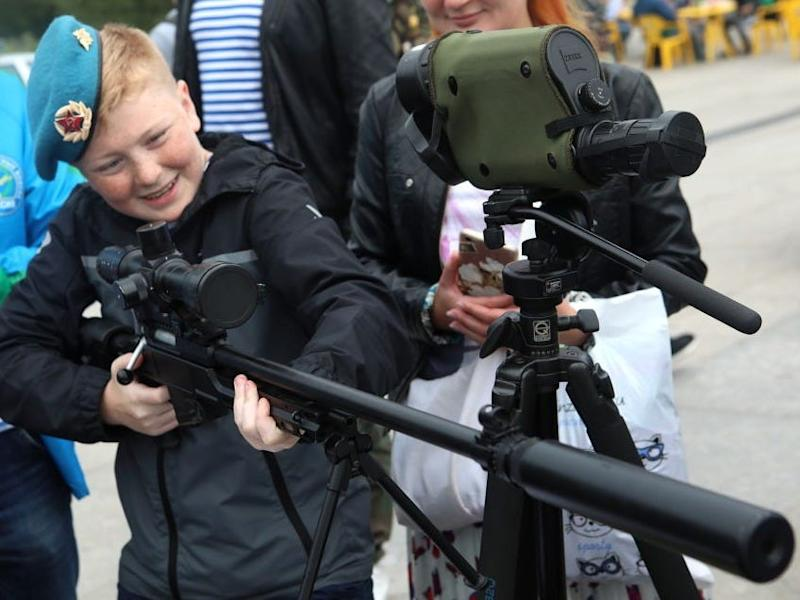 boy with a machine gun during celebrations marking Day of the Russian Airborne Troops, on August 2, 2019.