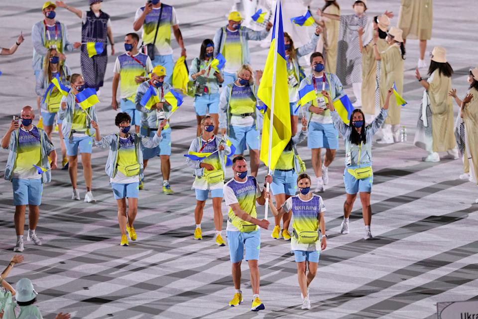 <p>TOKYO, JAPAN - JULY 23: Flag bearers Olena Kostevych and Bogdan Nikishin of Team Ukraine lead their team out during the Opening Ceremony of the Tokyo 2020 Olympic Games at Olympic Stadium on July 23, 2021 in Tokyo, Japan. (Photo by Patrick Smith/Getty Images)</p>