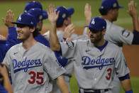 Los Angeles Dodgers center fielder Cody Bellinger celebrates their win against the Tampa Bay Rays in Game 3 of the baseball World Series Friday, Oct. 23, 2020, in Arlington, Texas. Dodgers beat the Rays 6-2 to lead the series 2-1 games. (AP Photo/Eric Gay)