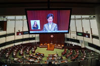 "A TV screen shows Hong Kong Chief Executive Carrie Lam delivering her policies at chamber of the Legislative Council in Hong Kong, Wednesday, Nov. 25, 2020. Lam said Wednesday that the city's new national security law has been ""remarkably effective in restoring stability"" after months of political unrest, and that bringing normalcy back to the political system is an urgent priority. (AP Photo/Kin Cheung)"